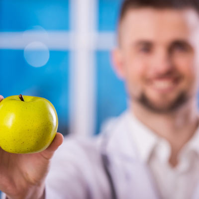 doctor holding apple